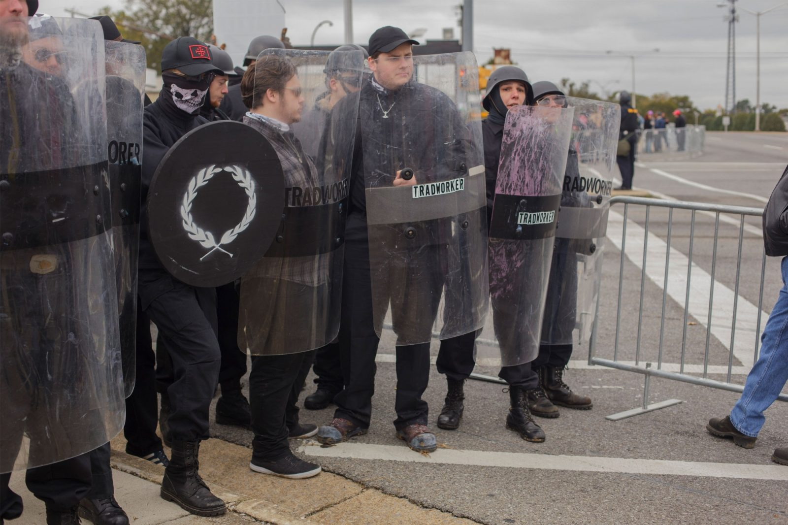 """White supremacists at a """"White Lives Matter"""" rally in Shelbyville, Tenn., on Oct. 28, 2017. Vasillios Pistolis identified himself in an online chat as the man holding the black shield."""